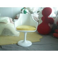 Tulip chair with arm with yellow cushion in white fiberglass exterior shell
