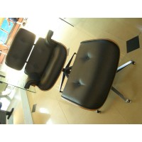 Eames style lounge chair and ottoman in aniline leather