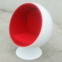 Ball chair in white shell with red fabric interior
